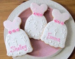 """Bridesmaids Cookies with their names How would you like to present each of your bridesmaids with a personalized bridesmaids cookie favor?A lovely bridal shower favor or wedding placecard.  The bridesmaid dress measures 4 3/4"""" x 3 1/2"""" and price includes individual cellophane bagging with matching curling ribbon.  Choose your color(s) and personalized text if any.  The cookies are sugar cookies made with real almond and vanilla extractPlease list the names in the comments section at checkout.*..."""