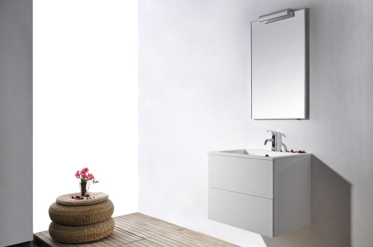 """Virta Oceana Wall Hung 30"""" Vanity in White.  With a sleek, rounded appearance, the vanity features a clean white finish, two soft-closing drawers and an integrated high quality acrylic sink.  The Oceana vanity has a clean modern look with a minimalist style that hovers above your floor and makes even the smallest bathroom appear more spacious.  Innovative storage and a complimentary framed mirror make this vanity stunning in its simplicity and practical with ample room for your toiletries."""