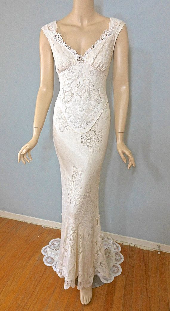 Bohemian wedding dress, made from vintage laces. Off the shoulder dress has sweetheart neckline framed with stunning cutwork lace, softly gathered
