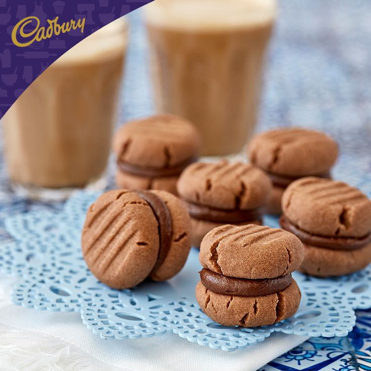 These cute Chocolate Yo-Yo Biscuits are just perfect for #visityourrelativeday! If you're searching for a gift to present to a loved one, something homemade and delicious is sure to impress. #bakeitcadbury #baking #CADBURYrecipes #chocolate #dessert #biscuits