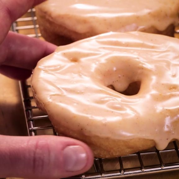 Grands! Pumpkin Spice Doughnuts will be the hit of your Friendsgiving! Surprise your friends with these easy doughnuts made with flaky layer biscuits and topped with pumpkin spice icing. No one can resist this fun dessert and it's the perfect treat to bring to all of your Thanksgiving gatherings!