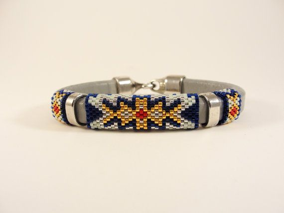 The Solaris Leather Bangle was inspired by the colors in a solar flare. This design incorporates red, black, silver-lined crystal for the flare, silver-lined Montana Blue, sea foam green and Duracoat Galvanized yellow gold seed beads for the core by Calisi on Etsy