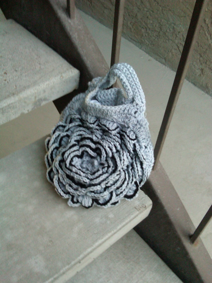 Light gray crochet rose purse. The rose is outlined in black. Very unique