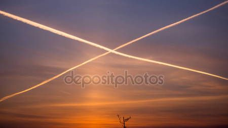 Cross from airplanes' gases on the morning sky — Stock Photo © WonderfulSnaps.com #148623241