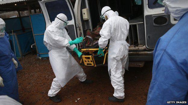 US cameraman in Liberia diagnosed with Ebola A burial team unloads an Ebola victim in Monrovia, Liberia, on 2 October 2014