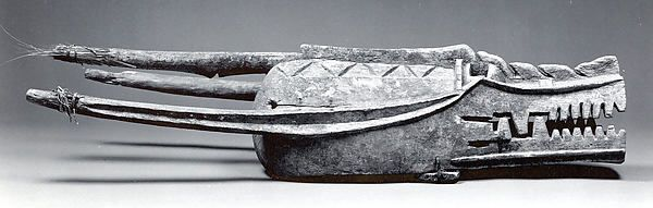 Helmet Mask  Date:19th–mid-20th century Geography:Côte d'Ivoire or Mali Culture:Senufo or Bamana Medium:Wood, grass, string Dimensions:H x W: 13 x 37in. (33 x 94cm)