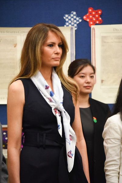 Melania Trump Photos Photos - US First Lady Melania Trump visits the the Bak Middle School of the Arts, with the People's Republic of China First Lady Peng Liyuan(not shown) on April 7, 2017 in West Palm Beach, Florida. / AFP PHOTO / Michele Eve Sandberg - Melania Trump And Chinese First Lady Peng Liyuan Visit West Palm Beach School