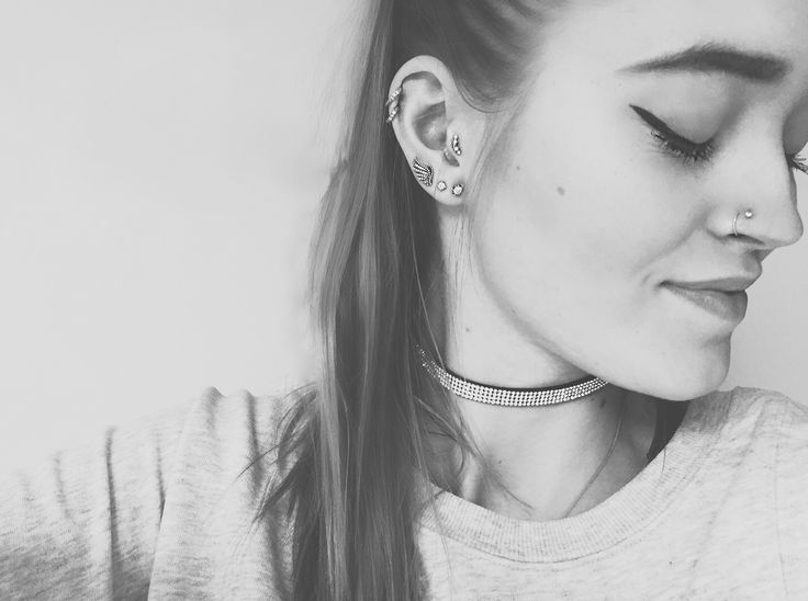 Double nose piercing, double helix, tragus piercing and triple earlopes