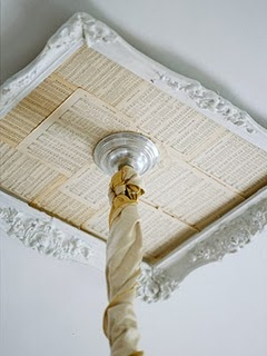 Frame and paper used to create a crown molding effect where a light fixture meets the ceiling.