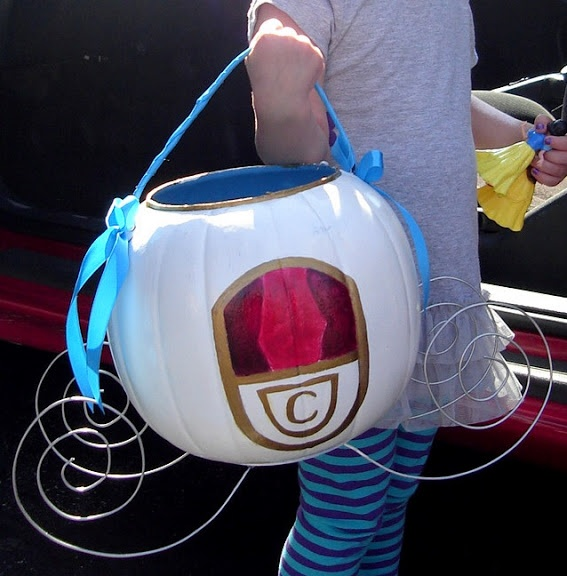 Cinderella Pumpkin Carriage. This is a  painted plastic Halloween pumpkin w/ wire hot glued to the bottom and the handle wrapped in ribbon. Forget the handle if being done for a Princess Event however. Add lights and put the top back on.