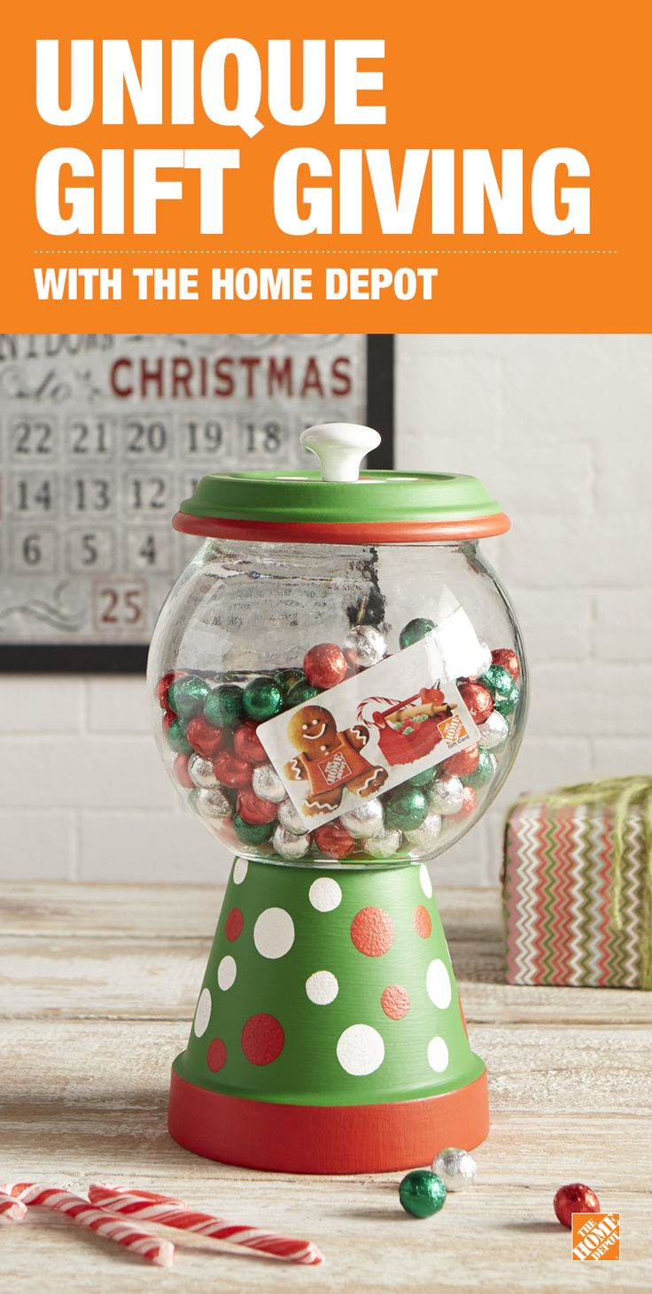 Sweeten up the gift of a gift card from The Home Depot with this DIY candy jar. Click through to purchase your gift card now.   • First, prime and paint a 6-in. terra cotta clay pot and saucer. • Once dry, hot glue the bottom of a 1/2  gallon fish bowl to the bottom of the clay pot. • Then, hot glue a door knob or other knob of your choice to the bottom of the saucer to make the lid. • Now you can fill the bowl with goodies and the gift card of your choice!