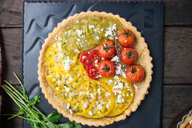 Tomato tarts. Heirloom tomatoes and goat cheese in a paprika crust.