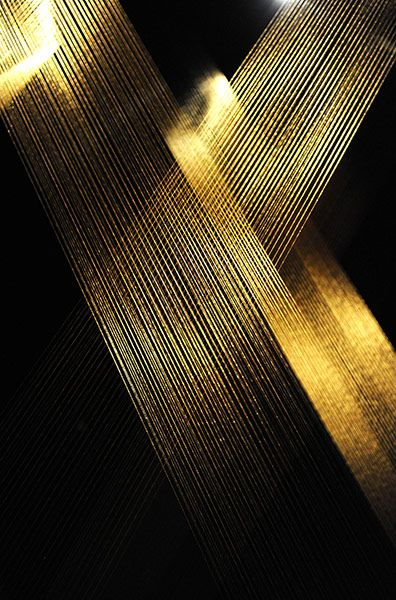 Tteia 1,C (Web) at the Serpentine Gallery, 2011 In the Serpentine's darkened north gallery, 'shafts of glimmering golden light strike this way and that from the ceiling to the floor', writes Adrian Searle.  Lygia Pape: Magnetized Space by Lygia Pape