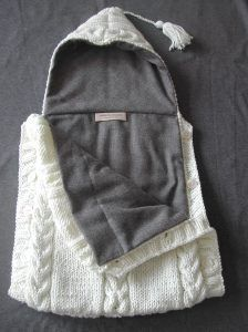 not sure what this is: but how cute? looks like a swaddler but for daytime? Iris at 1 now puts her blanket wrapped around her head for sleeping sooo? nid d'ange