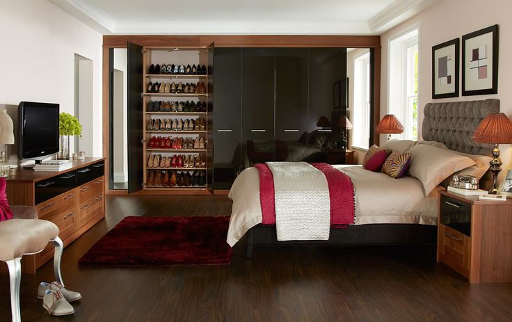 Plenty of shoe storage in the Modena Black Bedroom Furniture range http://www.sharps.co.uk/fitted-bedrooms/modena/
