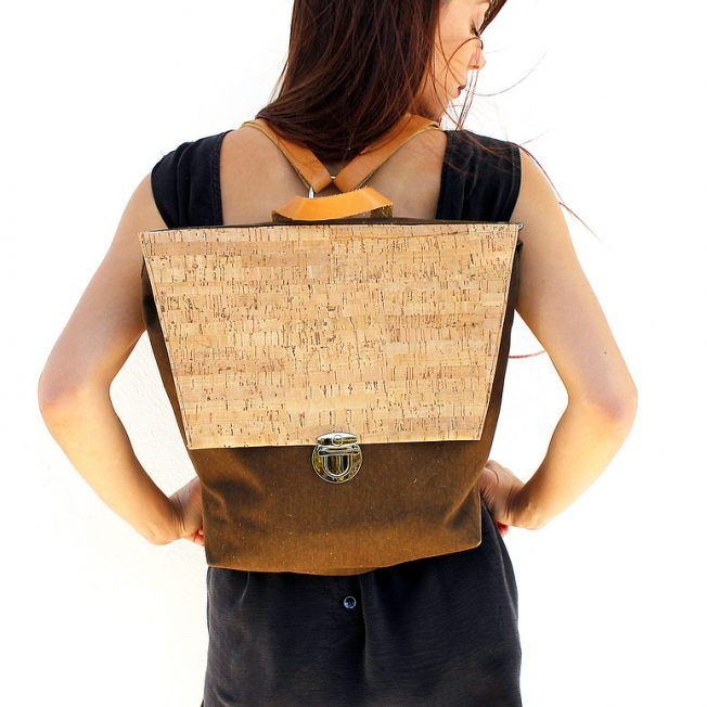 Tote backpack made of canvas featuring cork. It has an interior double pocket, chrome metal details and fully adjustable straps made of genuine leather in natural color. Care: Clean gently with a wet cotton cloth
