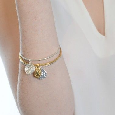 Our bangles are designed to be worn layered to show off the individual charms. BANGLE WITH STRING COIL - sterling silver £135. BANGLE WITH CAMEO - 18ct yellow gold vermeil £195. BANGLE WITH BAWBEE COIN - sterling silver £135.