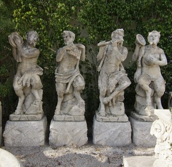 "LES QUATRES FAUNES MUSICIENS  19TH - 20TH CENTURY  UMBRIA, ITALY  SET OF FOUR STATUES   THE ""FAUNE"" IS A LEGENDARY CREATURE OF  ROMAN MYTHOLOGY COMPOSED OF A HUMAN TORSO,  POINTY EARS, TAIL, AND ANIMAL LIKE LEGS    HAND CARVED IN LIMESTONE    gs-2038 86""h x 24""w x 21""d"