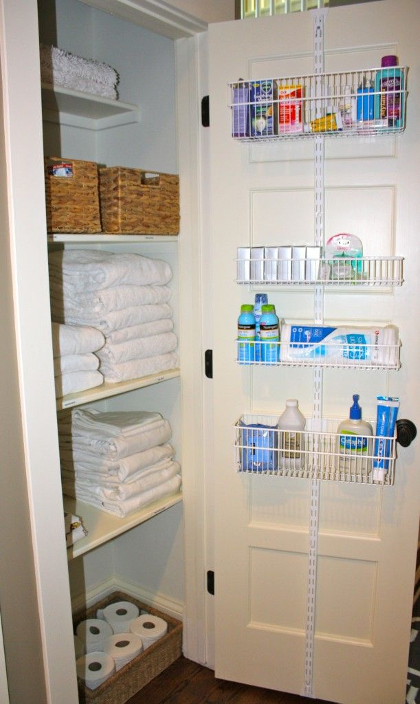 "I like this linen closet ""makeover"" with the baskets on the back of the door - for a deep closet"
