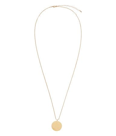 Gold-colored. Narrow metal chain necklace with a large disc-shaped pendant. Adjustable length, 29 1/2 - 32 3/4 in.