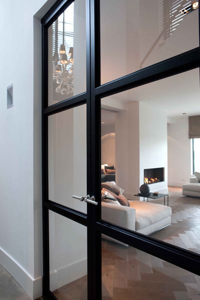 Metal glazed doors contemporary white living room pale stone linen