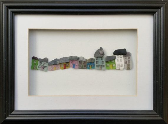 A mixture of genuine Cornish sea glass and stone make up the houses in this quaint and colourful village street set inside a 26cm x 35cm glazed box frame