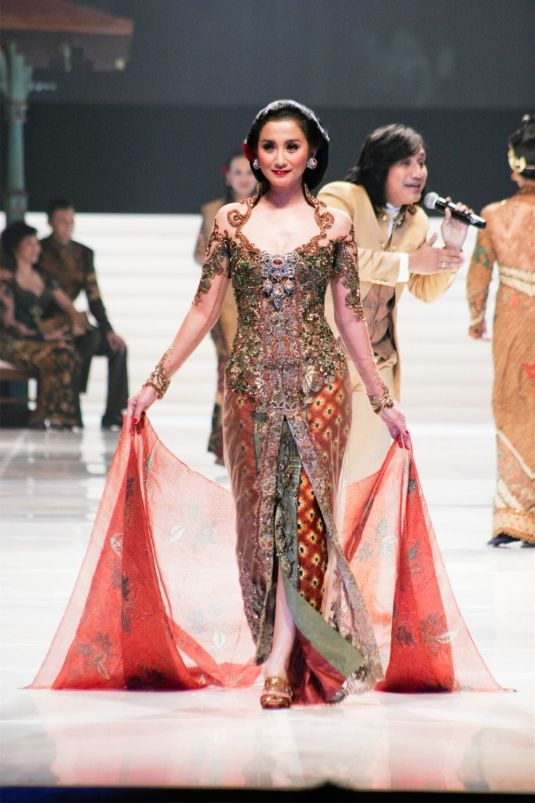 A Kebaya is a traditional blouse-dress combination that originates from Indonesia,Kebaya usually worn with a sarong or batik kain panjang, or other traditional woven garment such as ikat and songket