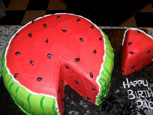 "watermelon cake. Small slice cut out of the ""watermelon"" for a smash cake."