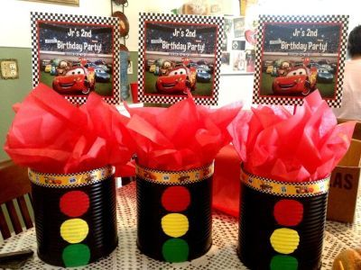 Disney Cars birthday centerpieces using coffee cans.  See more birthday parties for kids at www.one-stop-party-ideas.com