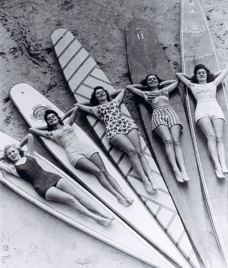 vintage women on top of some old-school surfboards. The photograph was taken by Ray Leighton between 1938 and 1946 at Manly beach in New South Wales, Australia.