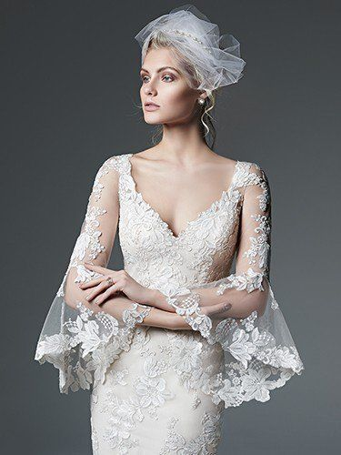 Sottero and Midgley - GABRIELLA, Bohemian beauty is found in this lace sheath wedding dress with gorgeous, illusion lace poet sleeves and a dramatic illusion back. Finished with pearl buttons over zipper closure.