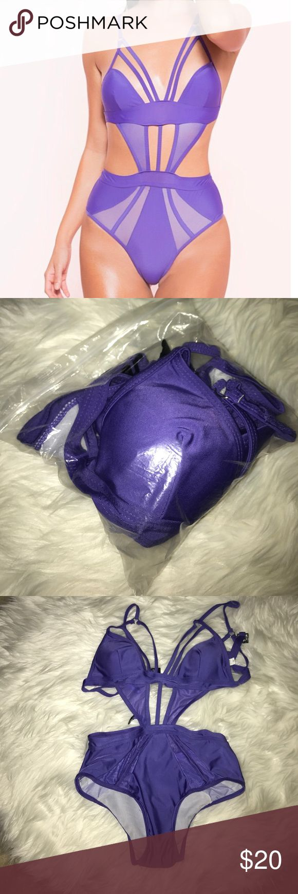 Purple swimsuit Purple one-piece cut-out swimsuit size Large (fits more like a medium with smaller breast cup sizes). Never worn. Swim One Pieces