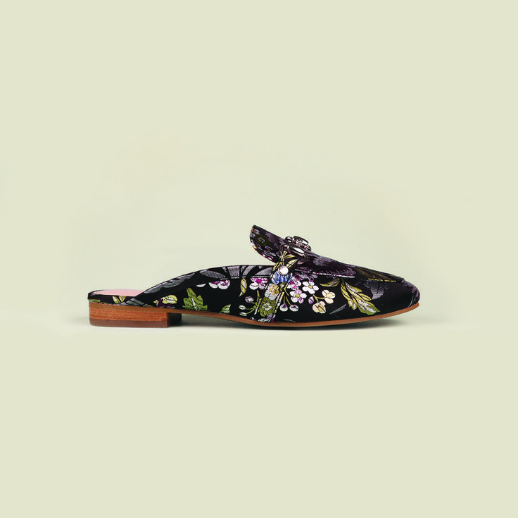 Delight in the details of the Siren 'Sana' mules with decorative brocade. Shop: https://www.shoeconnection.co.nz/womens/sandals-slides/sandals/siren-sana-leather-mule?c=Black%20Purple%20Brocade