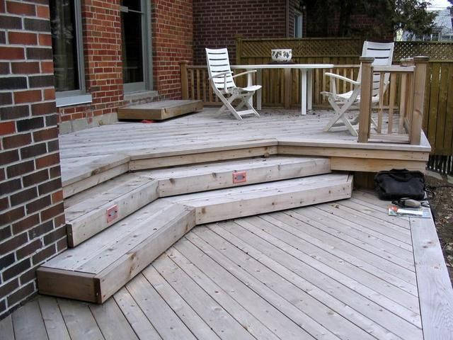 Two tiered deck with different sized deck boards running for Outdoor decking boards