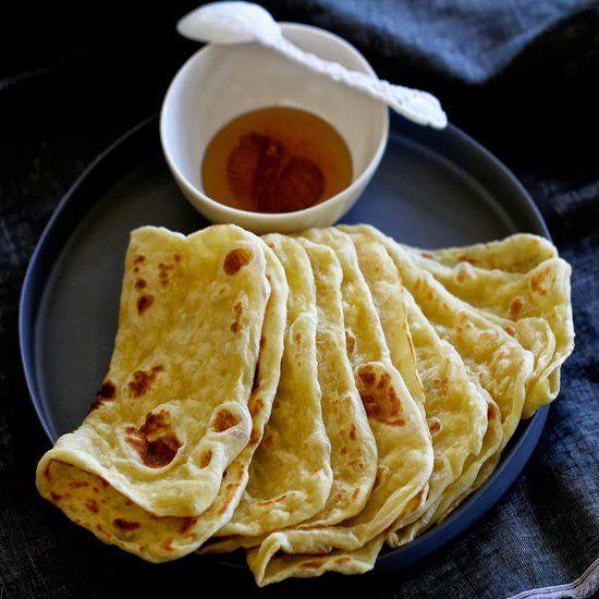 Rgaif. Moroccan breakfast pancake serve with honey.