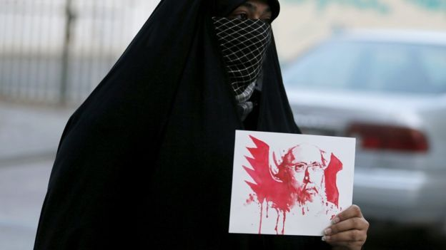 A protester holds an image of Sheikh Nimr in the Bahraini village of Sanabis