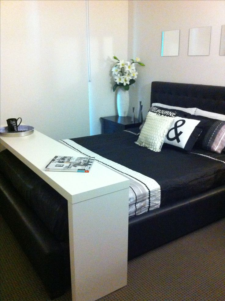 My Ikea Malm occasional table used over my bed! I it!!  Bed table
