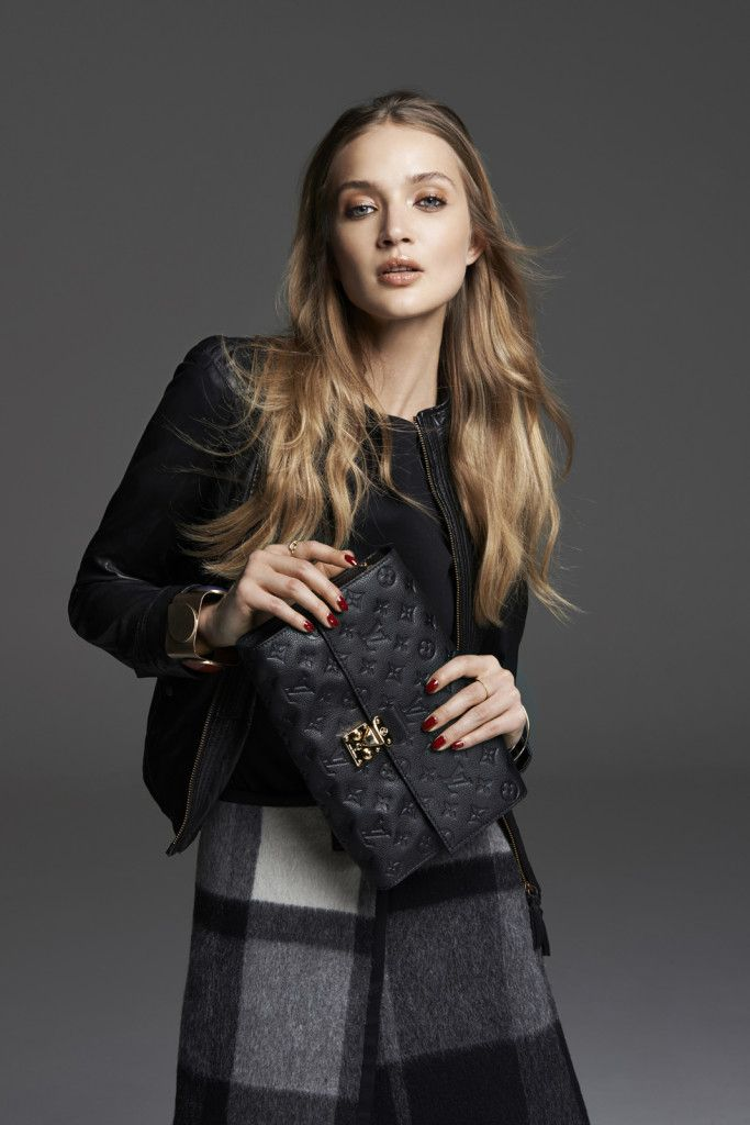 Black leather jacket and checked wool skirt