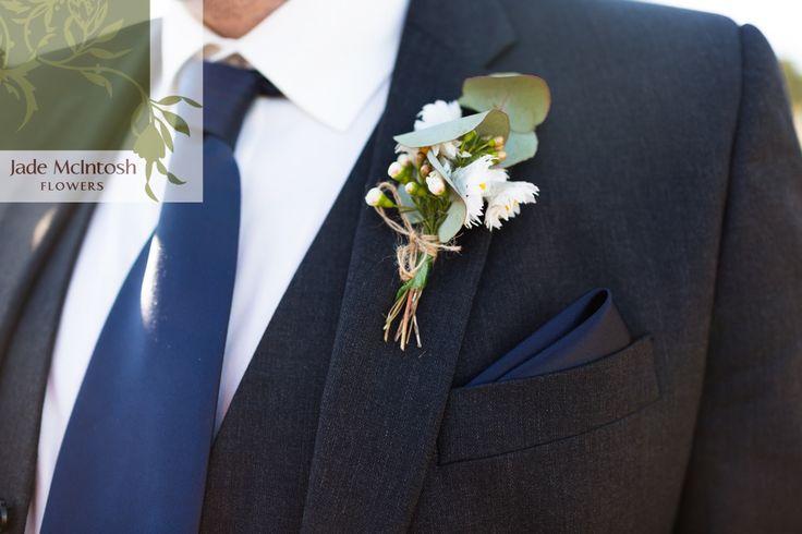 A tiny bouquet of natives tied up with jute. www.jademcintoshflowers.com.au www.somethingbluephotography.com.au
