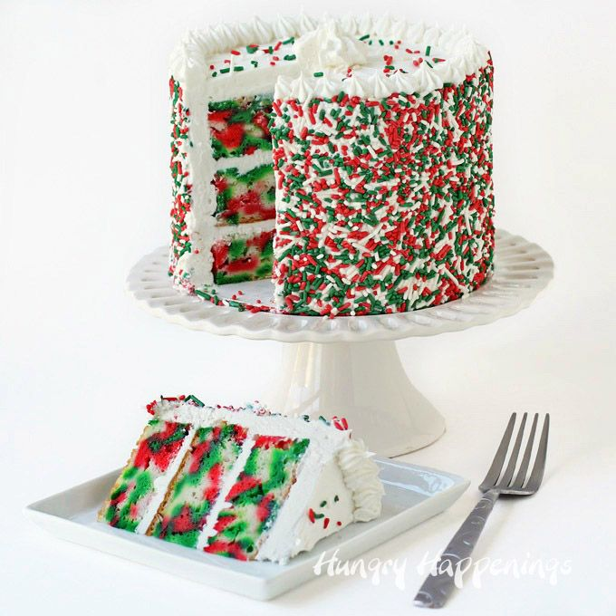 Three layer Tie-Dye Christmas Cake. Cut the first slice to reveal swirls of red, white and green color hiding inside.