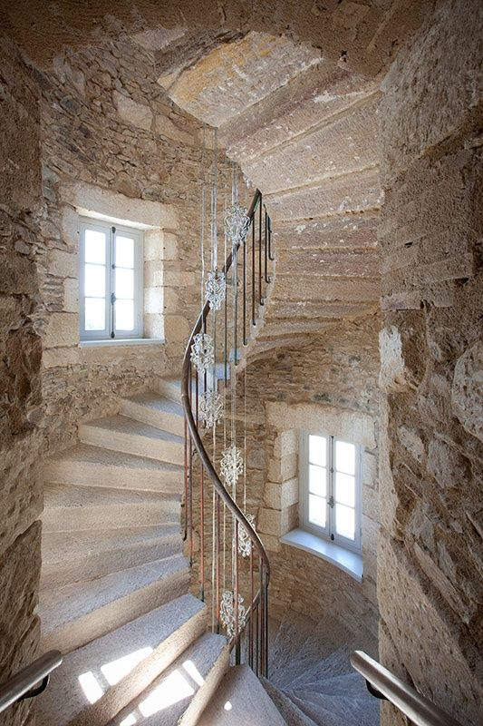 Spiral steps inside an old stone tower