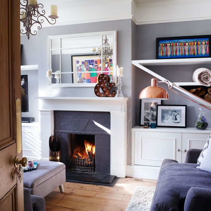 Planning alcove shelving around a fireplace in a living room? Take a look at this grey living room with diagonal shelving that's great for storing firewood