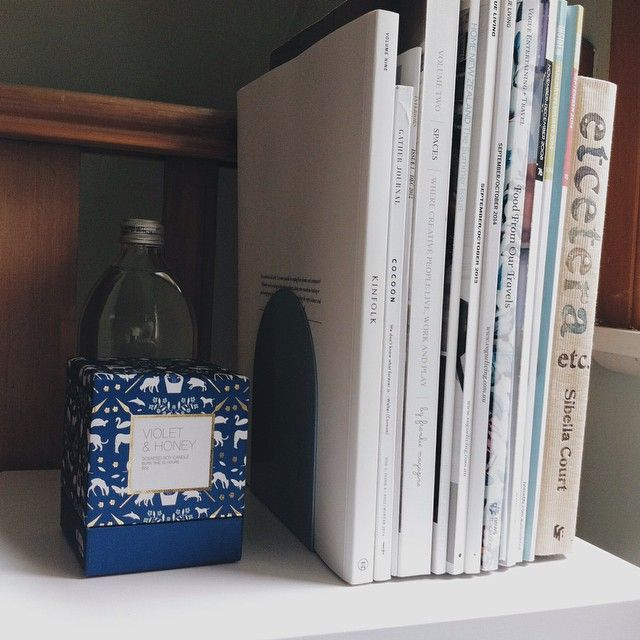 home office reading: citta candle box, Everyday Needs blue grey metal bookends, Kinfolk magazine, Gather journal, Volume Two Spaces by Frankie magazine, vogue living issue, inside out issues, and Etcetera by Sibella Court