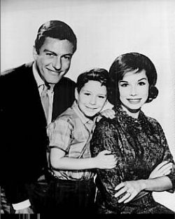 Dick Van Dyke (Rob Petrie), Larry Mathews (Ritchie Petrie), and Mary Tyler Moore (Laura Petrie)