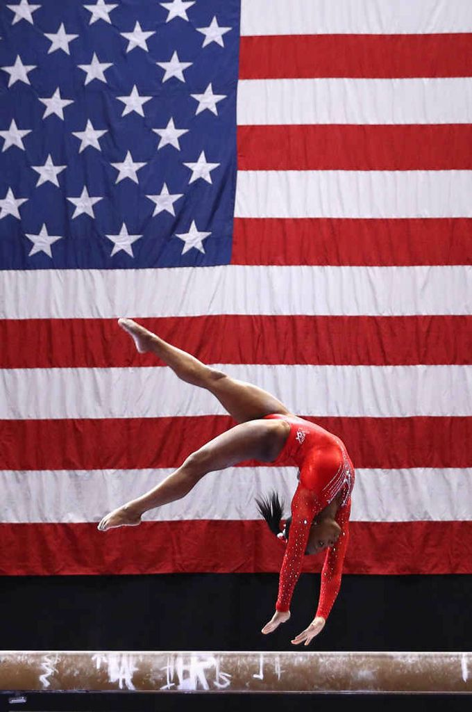 """Simone Biles in an American Olympic gymnast who was a member of the gold-medalist team dubbed """"The Final Five"""" at the 2016 Olympics. She is currently the most decorated American gymnast in history; a record which had not been broken for an entire decade previously. Biles has refused to discuss her race or her gender when it comes up in interviews because she wants the focus to be on her gymnastics skills and her athletic accomplishments. She is talented, not for a black woman, just talented."""