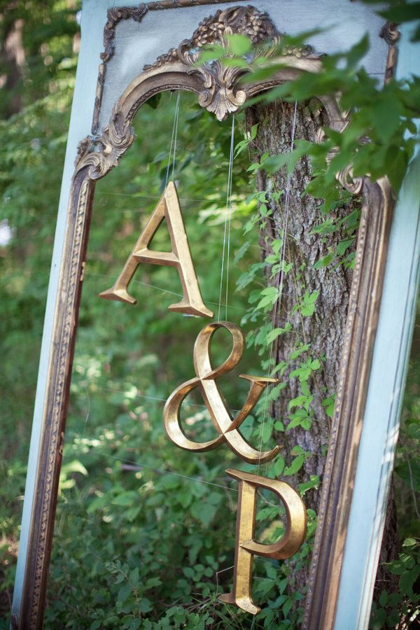 Initials hanging inside frame--easy peasy to do and make them in bright colors to add pop to a wall!