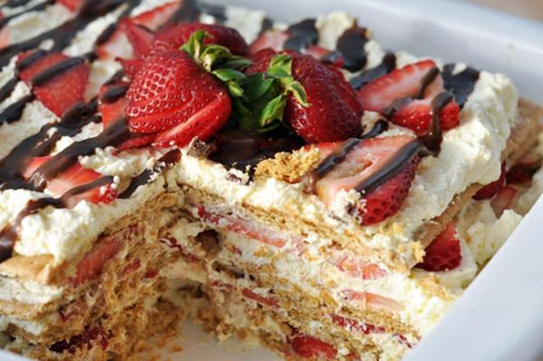 No Bake Strawberry Cake -- Layer Graham Crackers, Whipped Cream, Strawberries (and Bananas?), Repeat -- Chill for Several Hours, Drizzle w/ Chocolate and serve!