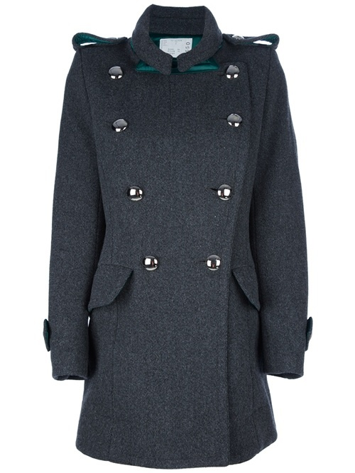 Grey wool blend coat from Sacai featuring a small collar, epaulettes, a green trim at the chest, a cross-over front closure with a button fastening, two flap pockets, long sleeves with tab detail cuffs, a large rear inverted box pleat, and a buttoned belt detail at the back of the waist.