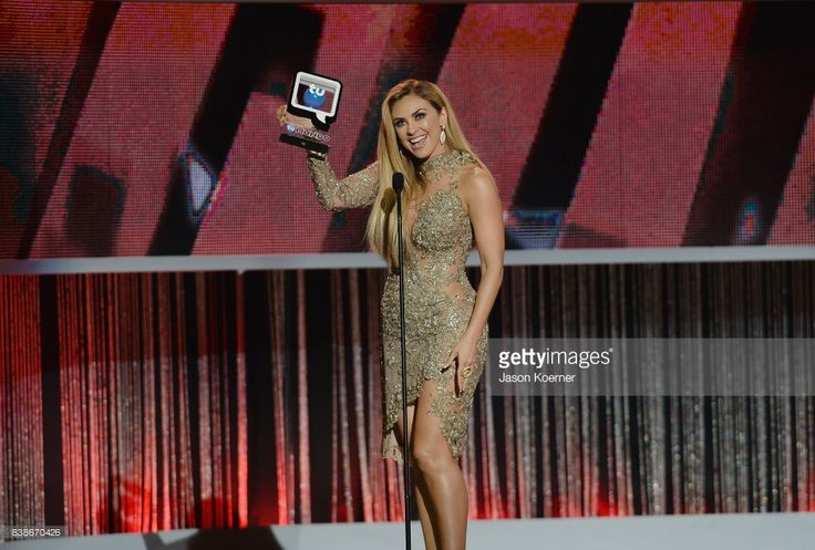 Aracely Arambula accepts award on stage at Telemundo's 2017 'Premios Tu Mundo' at American Airlines Arena on August 24, 2017 in Miami, Florida.