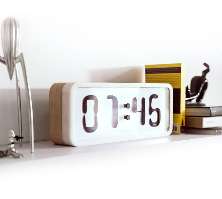 Rhei is a dynamic installation, an animated sculpture, an idea expressed in the form of a minimalistic, digital clock.